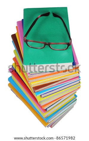 stacks of books and a glasses viewed from above, isolated on white background - stock photo