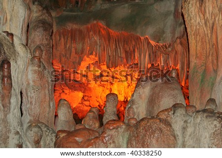 Stalactites and stalagmites in an underground cavern - stock photo