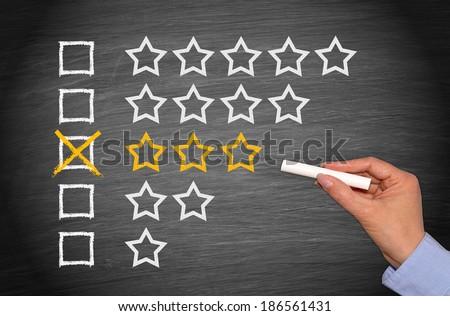 3 Stars - Average Performance - stock photo