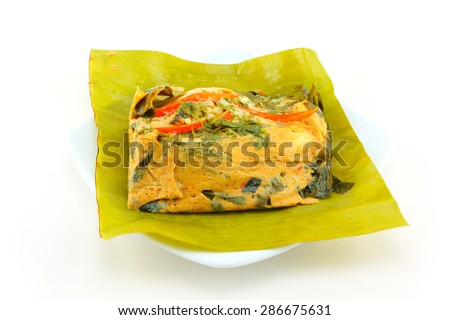 steamed fish with curry paste on white background - stock photo