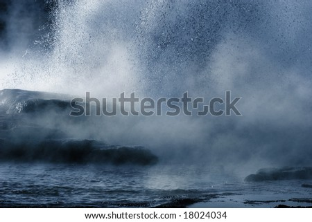 steamy Yellowstone geyser - stock photo