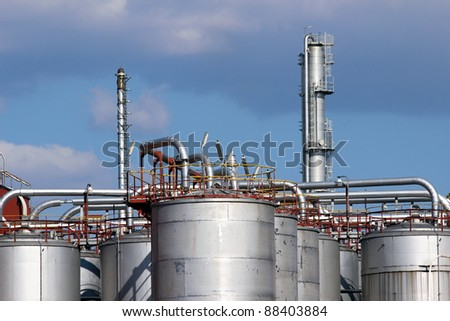 steel tanks and pipe in oil refinery - stock photo