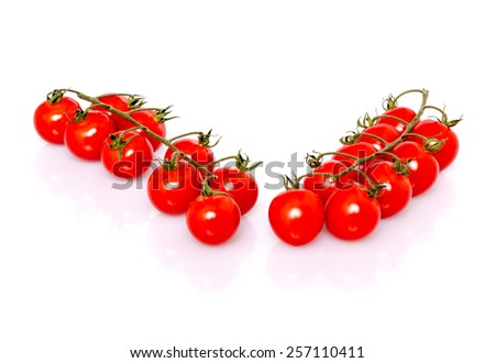 2 stems of fresh ripe cherry tomatoes with shadow and reflection on white background, studio shot - stock photo