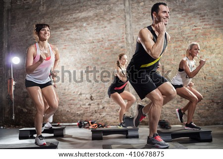step group training, smiling people doing exercise - stock photo
