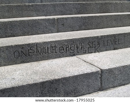 Step to the capital building marks one mile above sea level mark. - stock photo