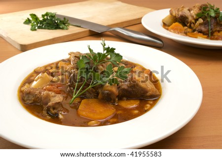 stew in white bowls - stock photo