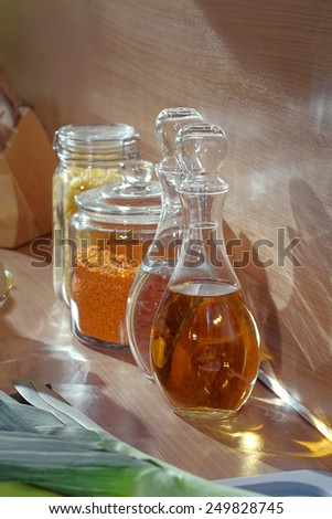 Still life in the kitchen juice in a jug and cereals on worktop - stock photo