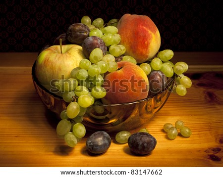 Still life with peaches, grapes, plums and apples - stock photo