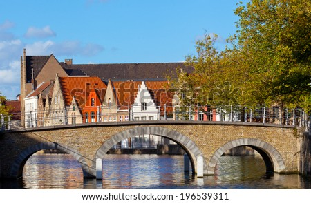 stone bridge over the channel in Bruges, Belgium - stock photo