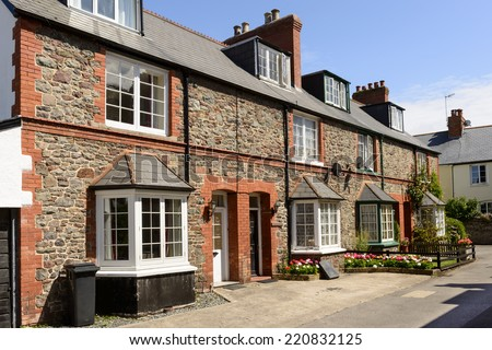 stone terrace at Porlock, Somerset view of old  terrace houses built with  stone  in historic touristic village of  Somerset. Shot in bright light  - stock photo