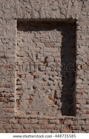Stone wall texture with the shadow - stock photo