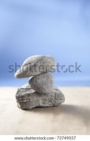 3 stones on wooden surface. shoot in Studio. - stock photo
