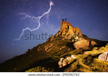 storm in the mountains is dangerous. Artistic lighting unreal mountain scenery while rock climbing in the wild mountains provides a unique fantastic effect unearthly planets with fabulous landscapes  - stock photo