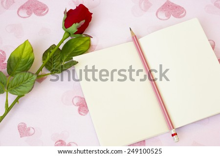 story in love,Write a love story down in your notebook - stock photo