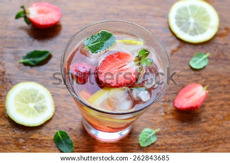 Strawberry and lemon cold drink with mint, close-up, selective focus, horizontal, top view - stock photo