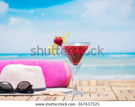 strawberry daiquiri cocktails on the beach - stock photo