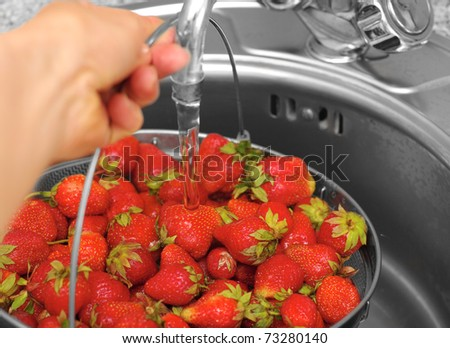 strawberry under current water - stock photo