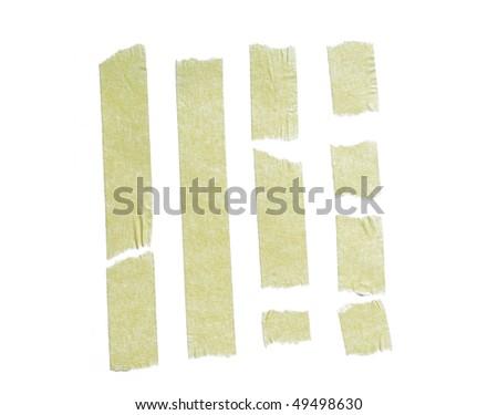 Strips of masking tape on white background - stock photo