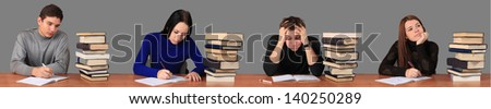 4 students in the classroom working on the exercise and expressing different emotions. - stock photo