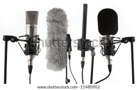 4 studio condenser microphones - stock photo