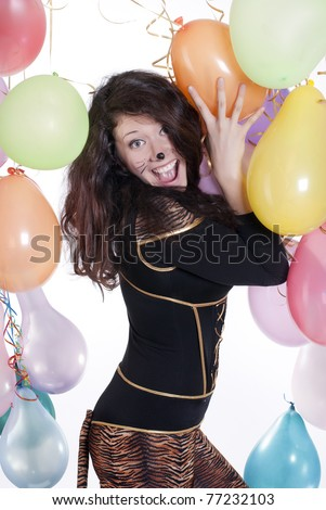 studio portrait of a shocked girl dressed as a cat - stock photo