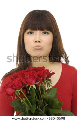 Studio portrait of asian beautiful woman with bouquet red rose