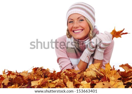 studio portrait of autumn woman in  yellow leaves - stock photo