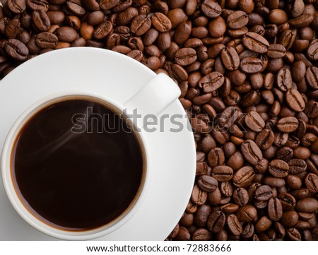 studio shot of a cup of coffee beans. - stock photo