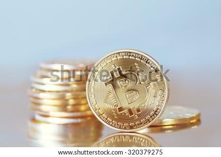 Studio shot of a golden Bitcoin  (new virtual money )  - stock photo