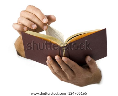 Studio shot of hands holding opened book