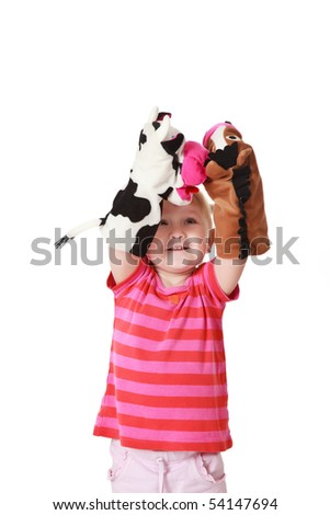 studio shot of little girl playing theater - stock photo
