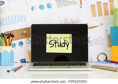 STUDY sticky note pasted on the laptop screen - stock photo