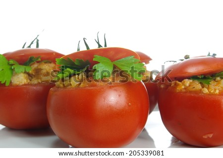 stuffed raw tomatoes  with meat and rice  - stock photo