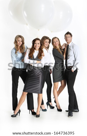 Success of corporate employees / Group of five young business people educated in the official costume posing against the big balloons  - stock photo