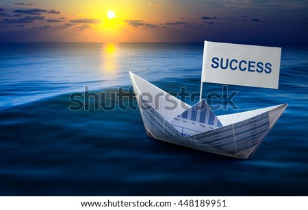 Success word with boat made from business paper graph on sea and sun light.For business success concept and financial concept ideas. - stock photo