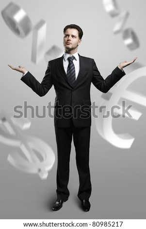 ? successful businessman and currency symbols - stock photo