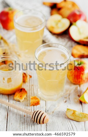 summer and autumn cooling drink , white brew or kvass with honey , apples , raisins and bread on wooden background