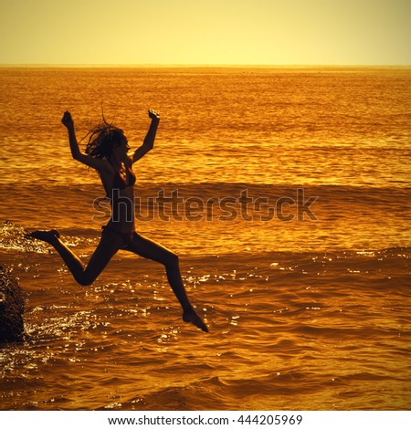 Summer fun lifestyle. Happy girl playing in the sea. Summer vacation and healthy lifestyle concept