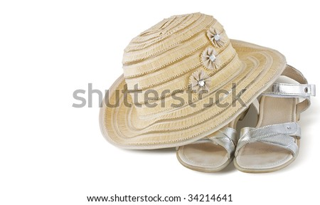summer hat with silver sandals, isolated on white