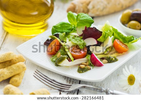 Summer leaf salad on a wooden background