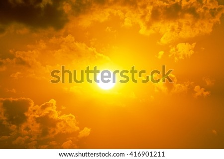 Sun, Centered Yellow orange summer sun light burst with cloud on the sky. If you enjoy the hot and glittering summer sun, that is the background with space for your message.   - stock photo