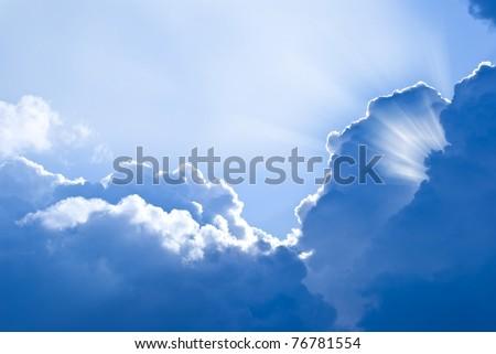 sun rays pushing through a dense clouds - stock photo