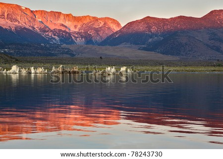 Sunrise at Mono Lake in the crater of an ancient extinct volcano. Shallow lake, a multitude of picturesque reefs Tufa. Magically beautiful sunrise.