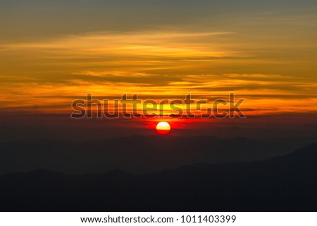 sunrise with clouds and mountains