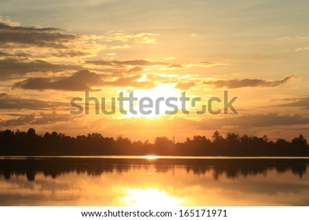 Sunset at Reservoir in the city of Amnat Charoen,Thailand. - stock photo