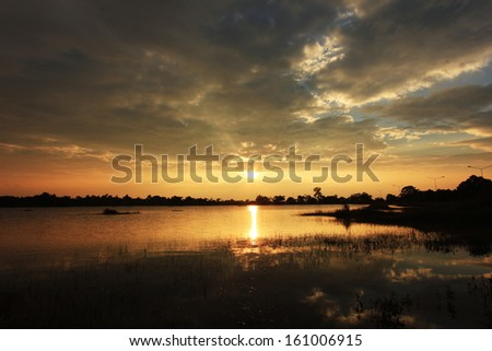 Sunset at the city of Amnat Charoen,Thailand. - stock photo