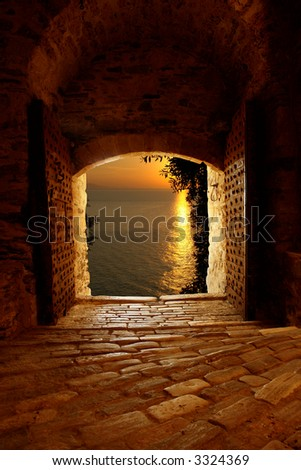 Sunset through the old castle on Mount Athos, Greece - stock photo