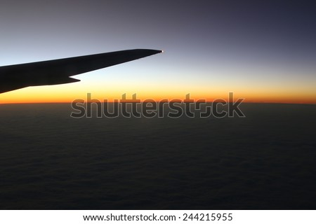 Sunset view from the airplane window height of 10 000 km.