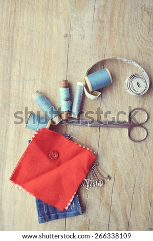 supplies and accessories for sewing on a light wooden table