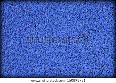 Surface of blue rubber swimming pool mat  - stock photo